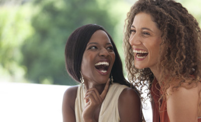 Women laughing together outdoors
